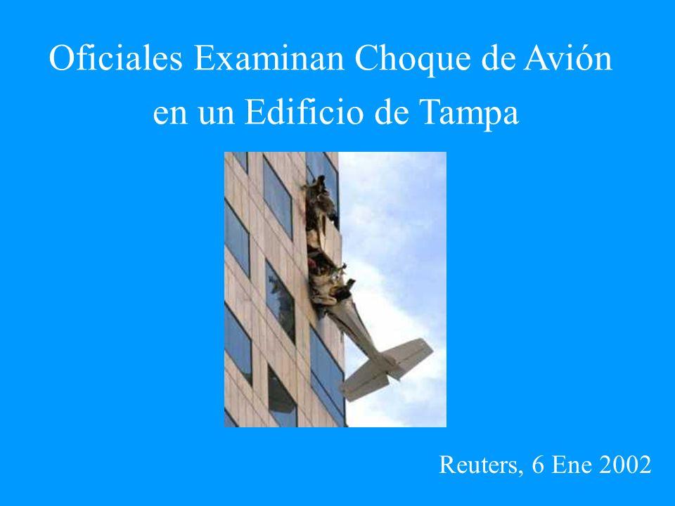 Oficiales Examinan Choque de Avión en un Edificio de Tampa Reuters, 6 Ene 2002