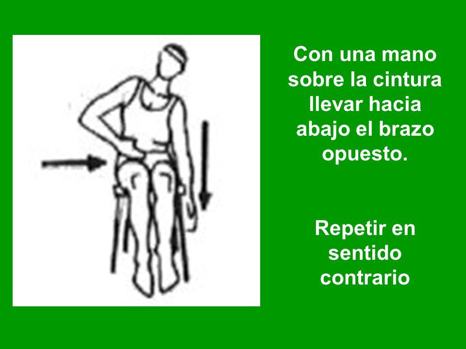 Con una mano sobre la cintura llevar hacia abajo el brazo opuesto. Repetir en sentido contrario