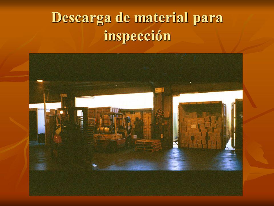 Descarga de material para inspección
