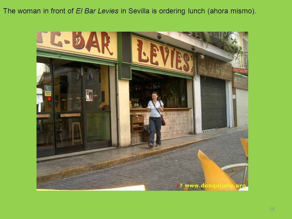 58 The woman in front of El Bar Levies in Sevilla is ordering lunch (ahora mismo).