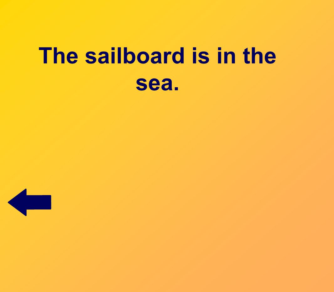 The sailboard is in the sea.