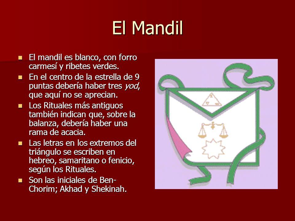 El Mandil El mandil es blanco, con forro carmesí y ribetes verdes. El mandil es blanco, con forro carmesí y ribetes verdes. En el centro de la estrell