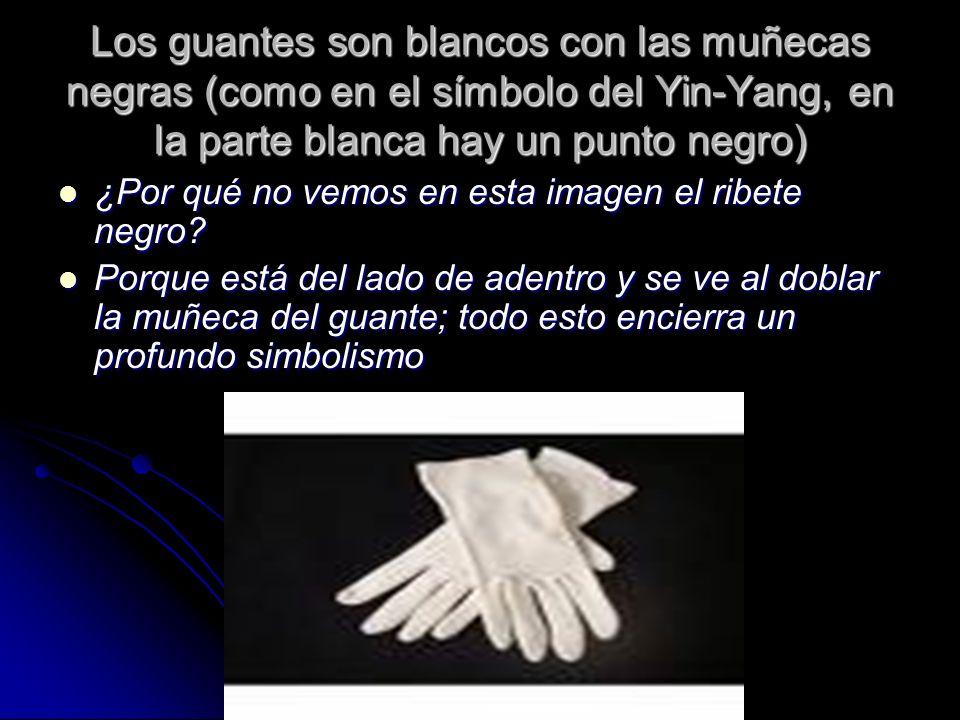 Los guantes son blancos con las muñecas negras (como en el símbolo del Yin-Yang, en la parte blanca hay un punto negro) ¿Por qué no vemos en esta imag