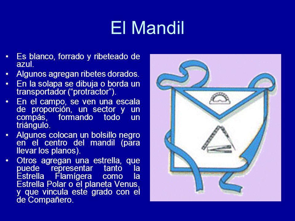 El Mandil Es blanco, forrado y ribeteado de azul. Algunos agregan ribetes dorados. En la solapa se dibuja o borda un transportador (protractor). En el