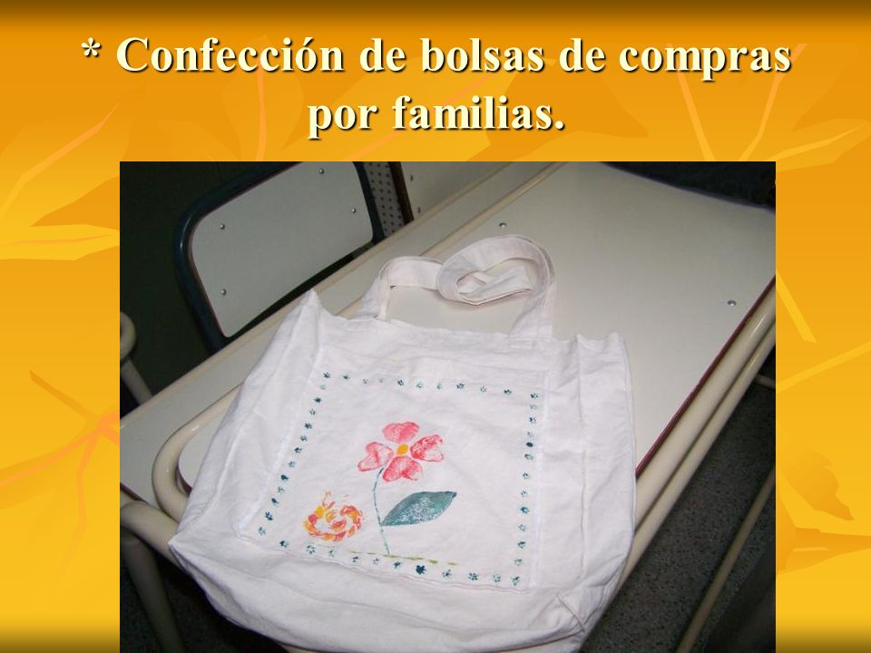 * Confección de bolsas de compras por familias.