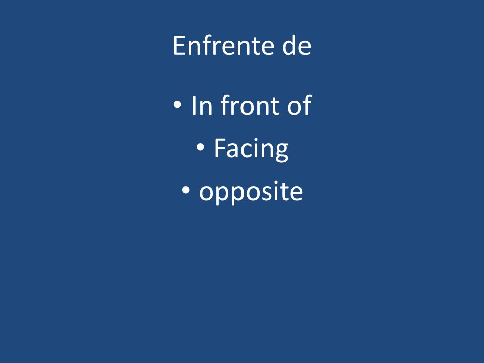 Enfrente de In front of Facing opposite