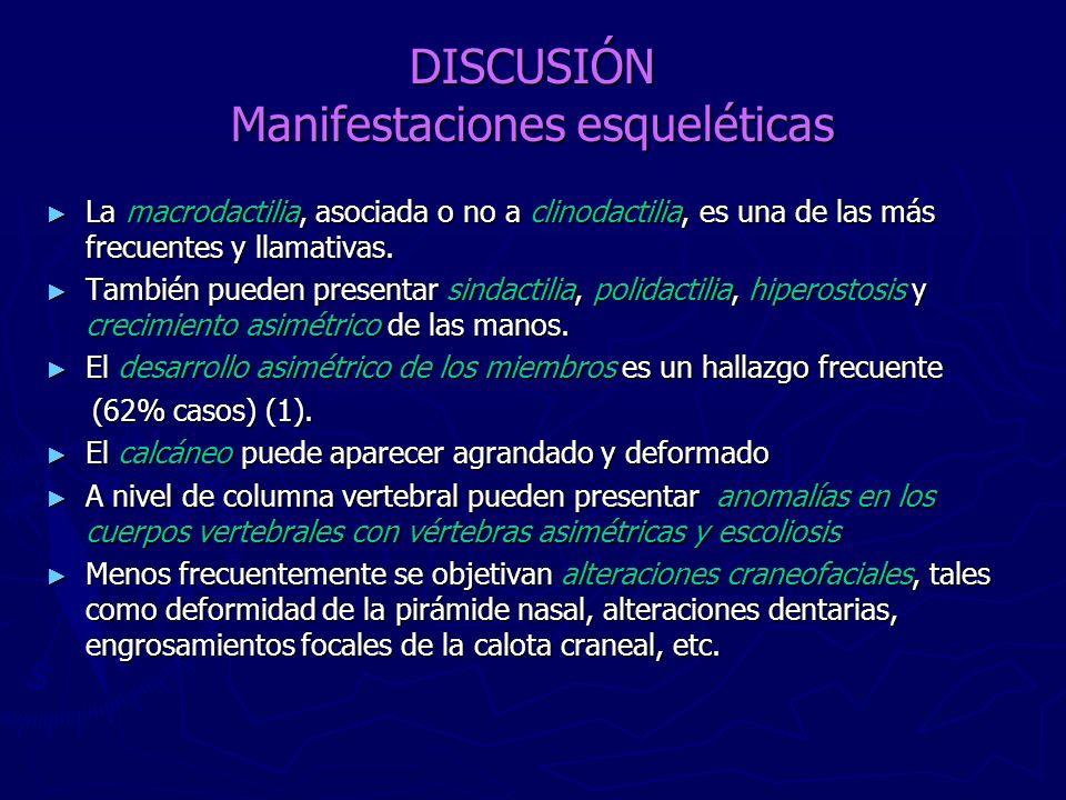 DISCUSIÓN Manifestaciones esqueléticas La macrodactilia, asociada o no a clinodactilia, es una de las más frecuentes y llamativas. La macrodactilia, a