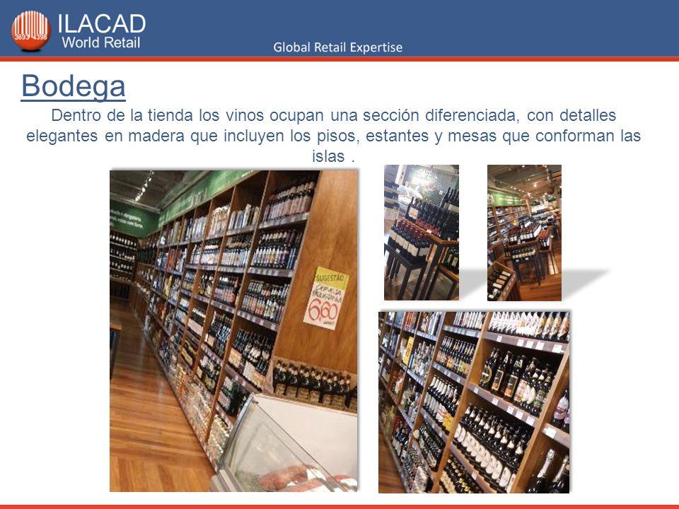 Dentro de la tienda los vinos ocupan una sección diferenciada, con detalles elegantes en madera que incluyen los pisos, estantes y mesas que conforman