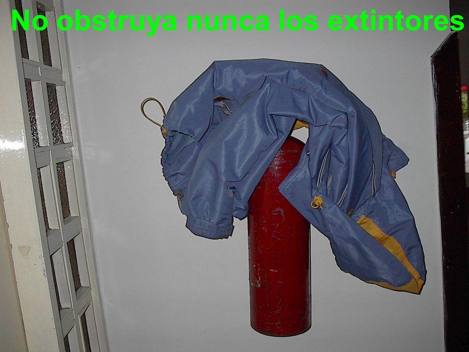 No obstruya nunca los extintores