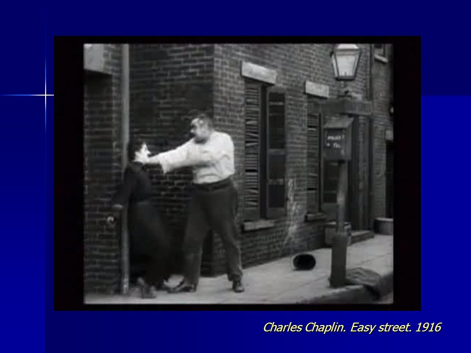 Charles Chaplin. Easy street. 1916