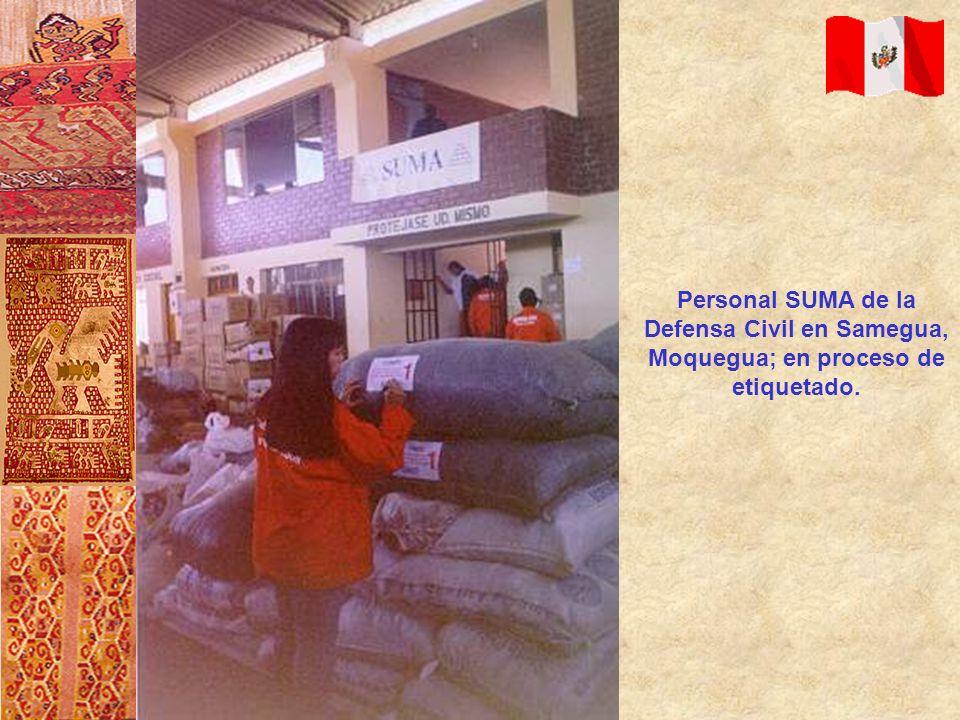 Personal SUMA de la Defensa Civil en Samegua, Moquegua; en proceso de etiquetado.