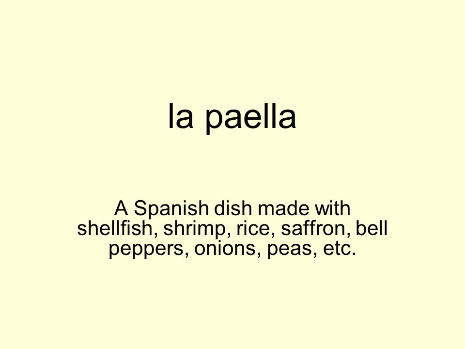 la paella A Spanish dish made with shellfish, shrimp, rice, saffron, bell peppers, onions, peas, etc.