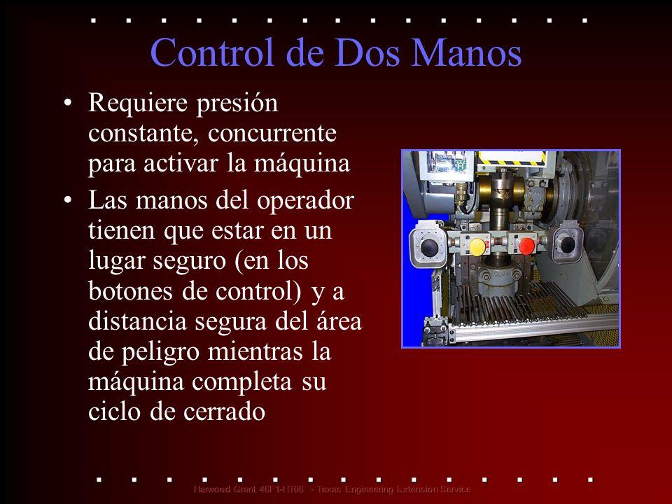 Control de Dos Manos. Requiere presión constante, concurrente para activar la máquina Las manos del operador tienen que estar en un lugar seguro (en l