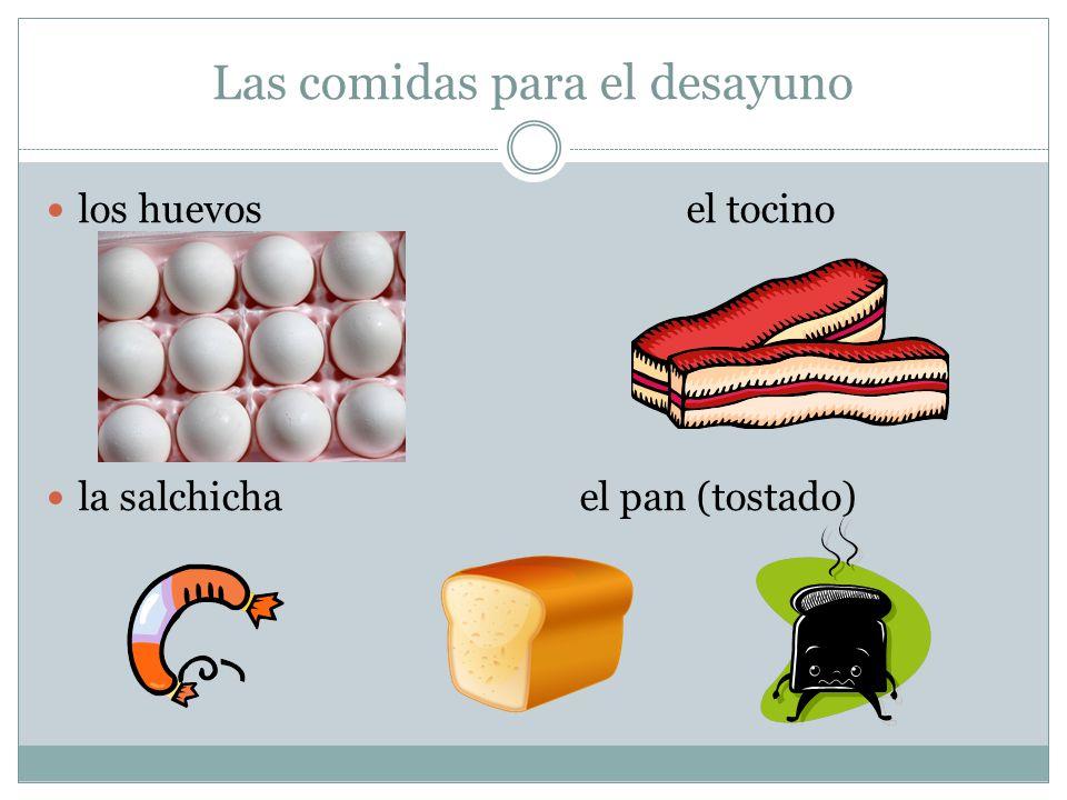 Las comidas para el desayuno los huevosel tocino la salchichael pan (tostado)