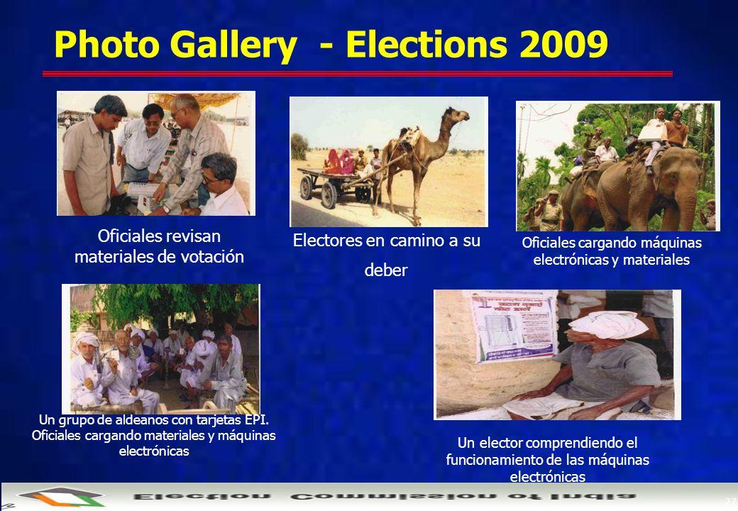 27 Photo Gallery - Elections 2009 Oficiales revisan materiales de votación Oficiales cargando máquinas electrónicas y materiales Un grupo de aldeanos con tarjetas EPI.