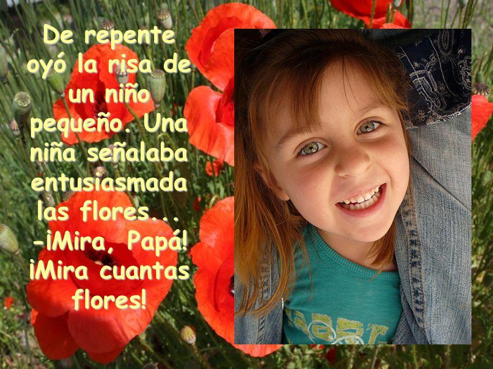 De repente oyó la risa de un niño pequeño.Una niña señalaba entusiasmada las flores...