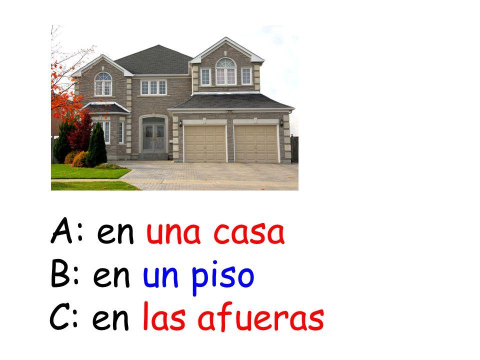 A: en una casa B: en un piso C: en las afueras