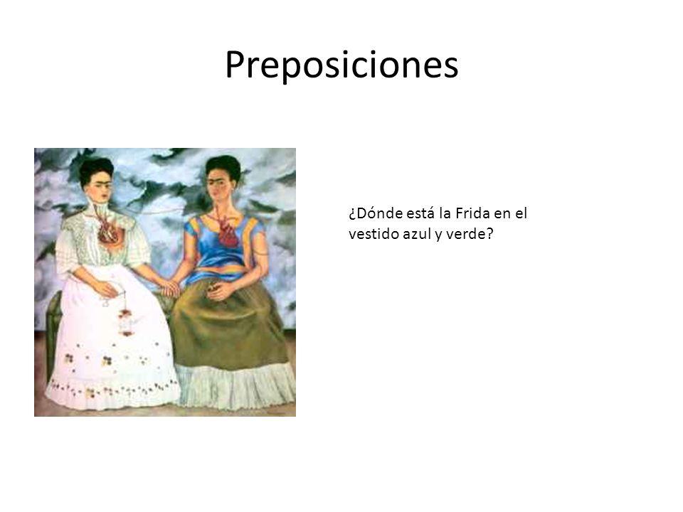 Preposiciones ¿Dónde está la Frida en el vestido azul y verde?