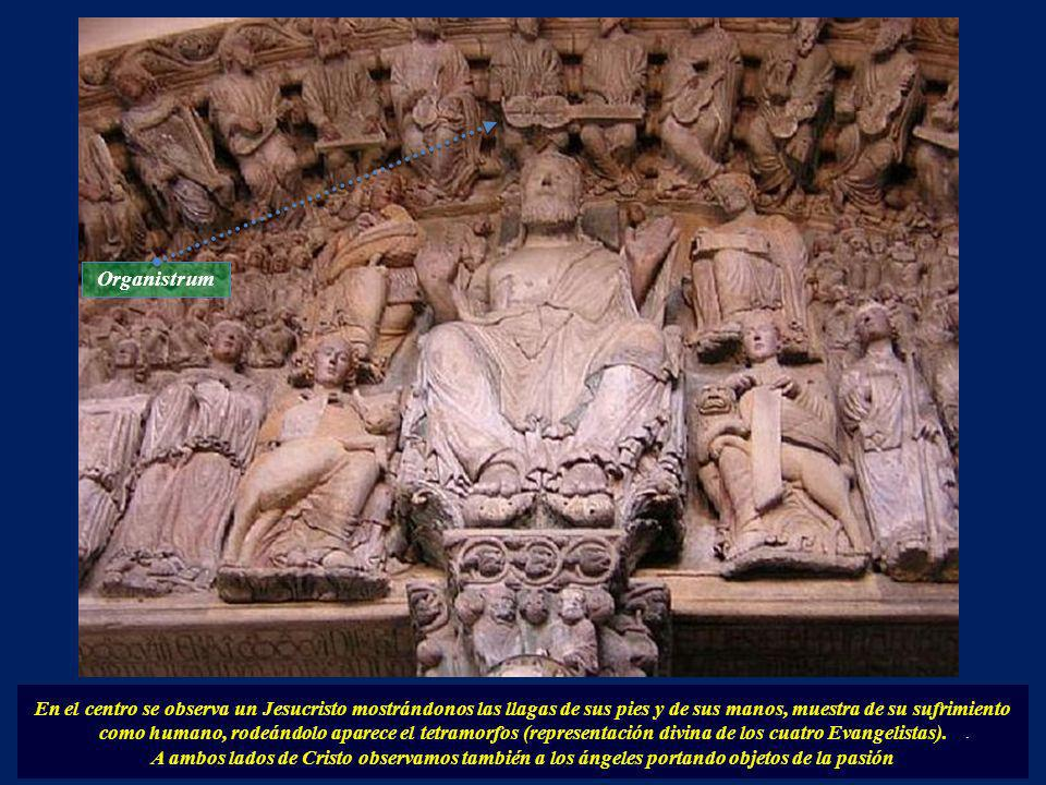 En el centro se observa un Jesucristo mostrándonos las llagas de sus pies y de sus manos, muestra de su sufrimiento como humano, rodeándolo aparece el tetramorfos (representación divina de los cuatro Evangelistas).