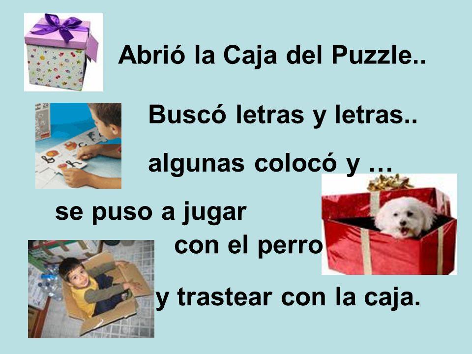 Abrió la Caja del Puzzle.. Buscó letras y letras.. algunas colocó y … se puso a jugar y trastear con la caja. con el perro
