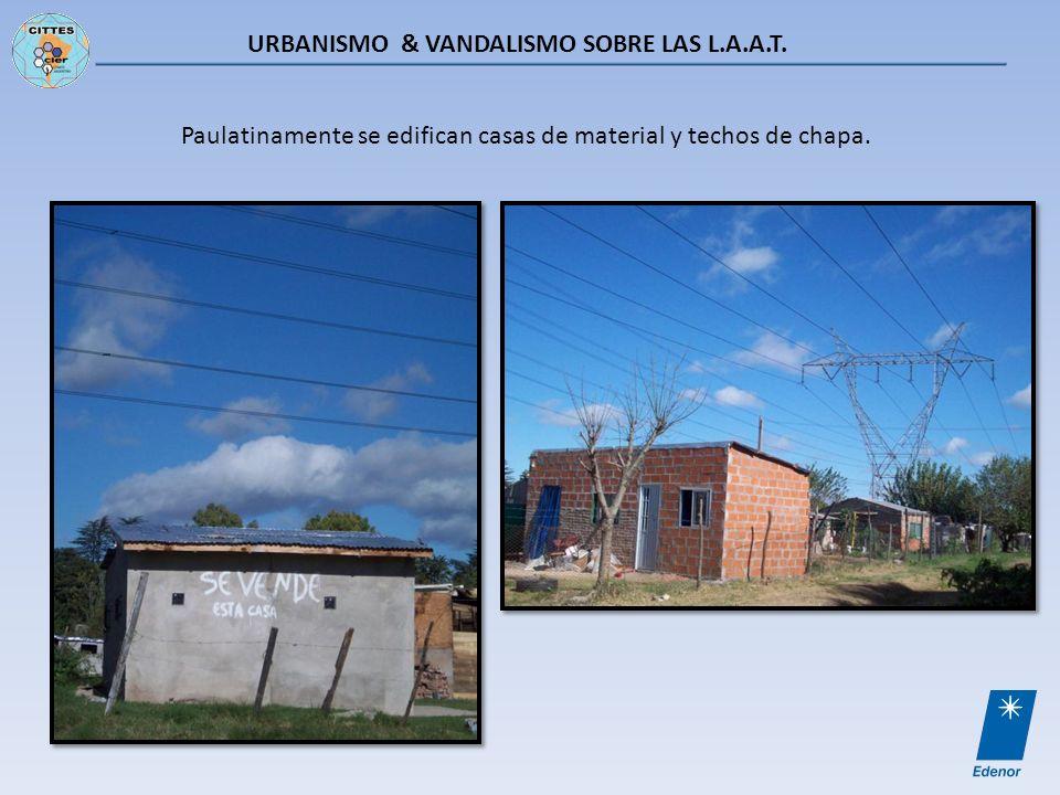 URBANISMO & VANDALISMO SOBRE LAS L.A.A.T. Paulatinamente se edifican casas de material y techos de chapa.