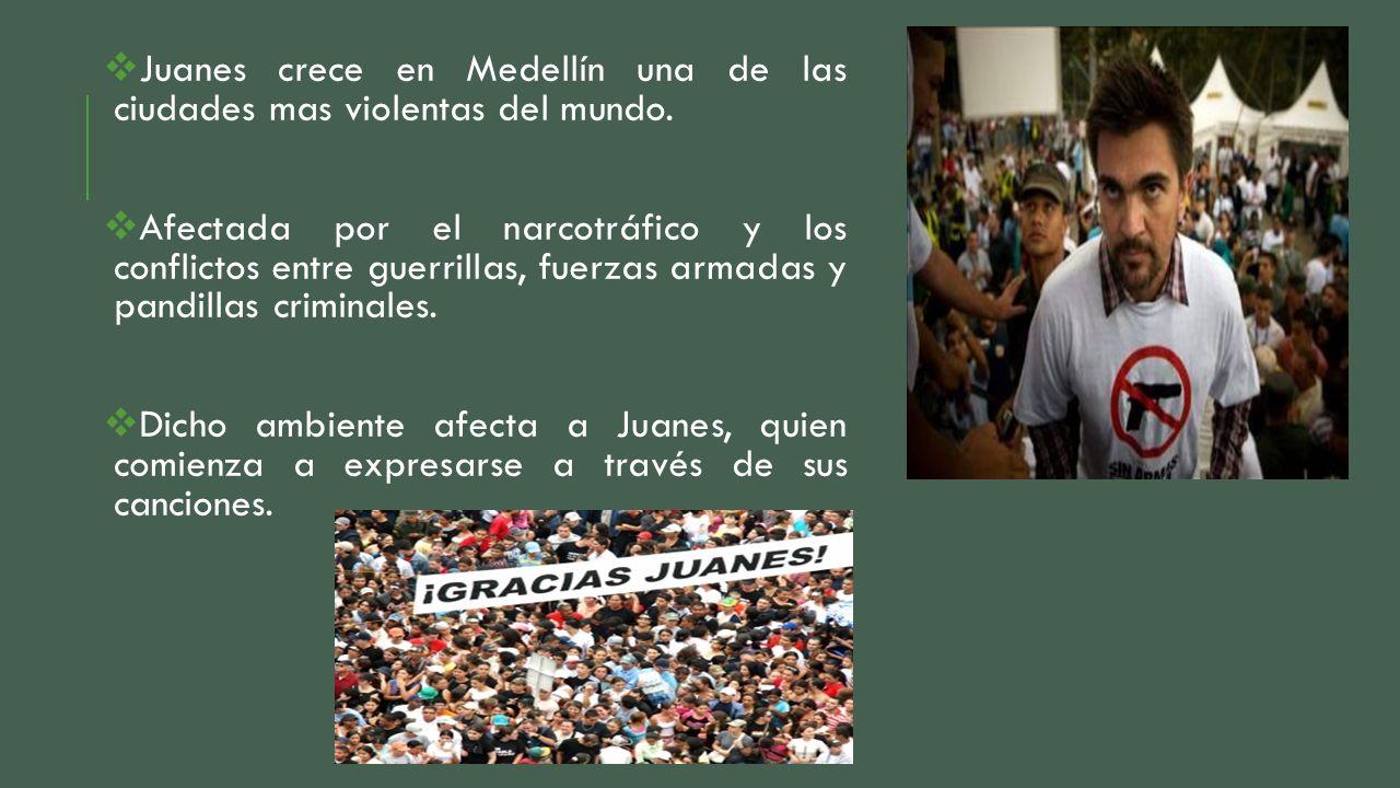 Juanes crece en Medellín una de las ciudades mas violentas del mundo. Afectada por el narcotráfico y los conflictos entre guerrillas, fuerzas armadas