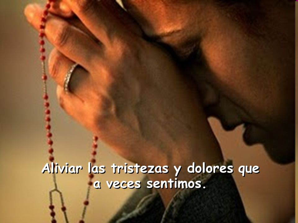 Con un rosario en la mano, de rodillas nosotros pedimos Con un rosario en la mano, de rodillas nosotros pedimos