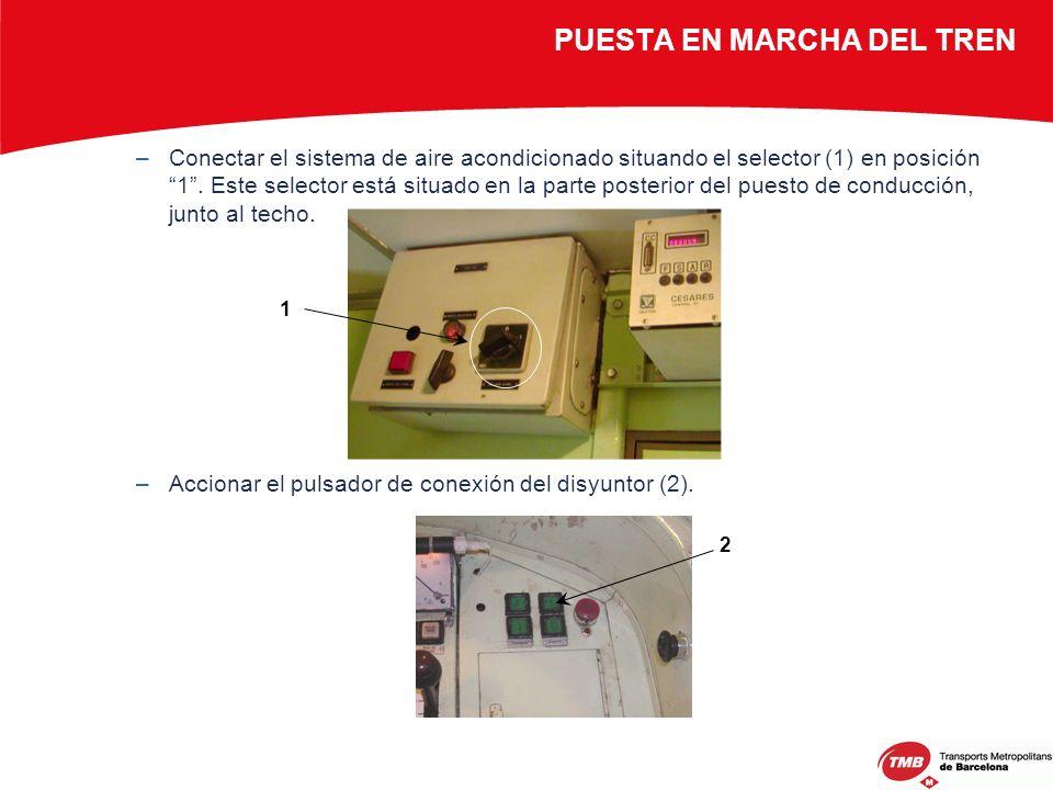 –Conectar el sistema de aire acondicionado situando el selector (1) en posición 1. Este selector está situado en la parte posterior del puesto de cond