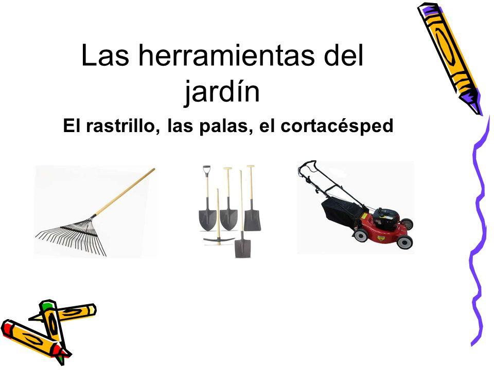 Las herramientas del jardín El rastrillo, las palas, el cortacésped