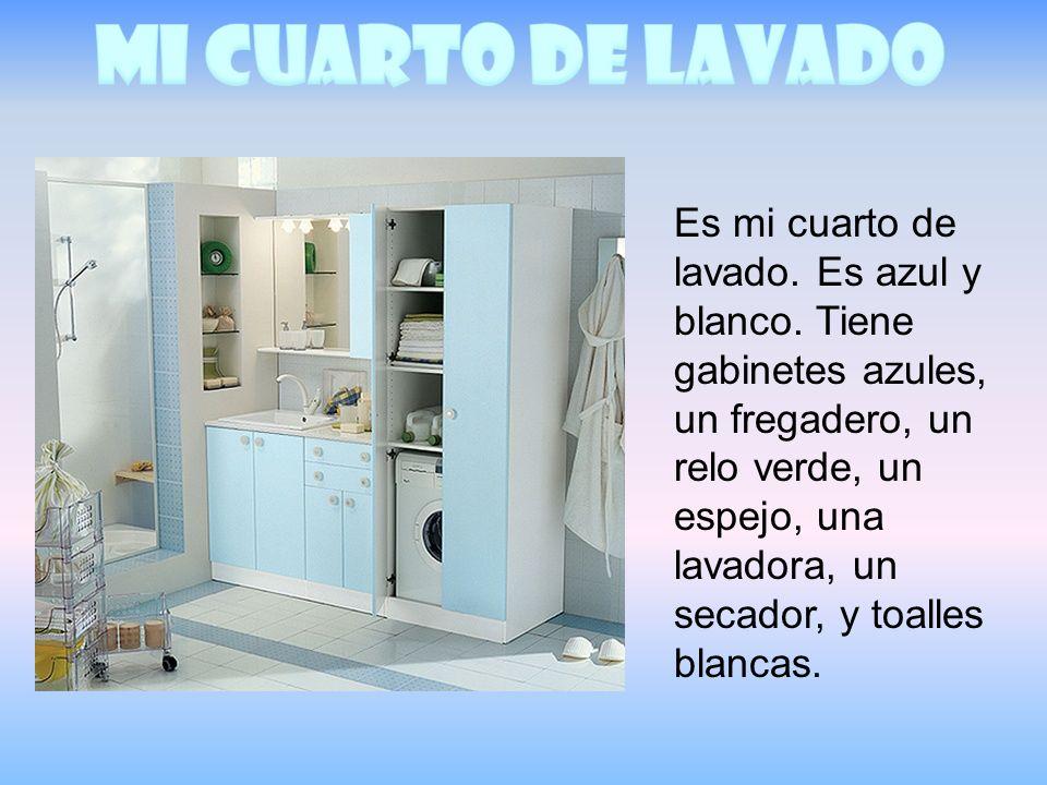 Es mi cuarto de lavado. Es azul y blanco. Tiene gabinetes azules, un fregadero, un relo verde, un espejo, una lavadora, un secador, y toalles blancas.