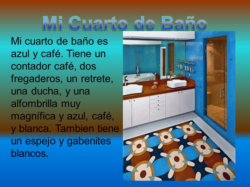 Mi cuarto de baño es azul y café. Tiene un contador café, dos fregaderos, un retrete, una ducha, y una alfombrilla muy magnífica y azul, café, y blanc
