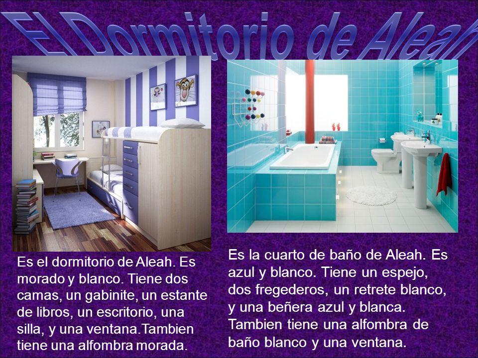 Es la cuarto de baño de Aleah. Es azul y blanco. Tiene un espejo, dos fregederos, un retrete blanco, y una beñera azul y blanca. Tambien tiene una alf