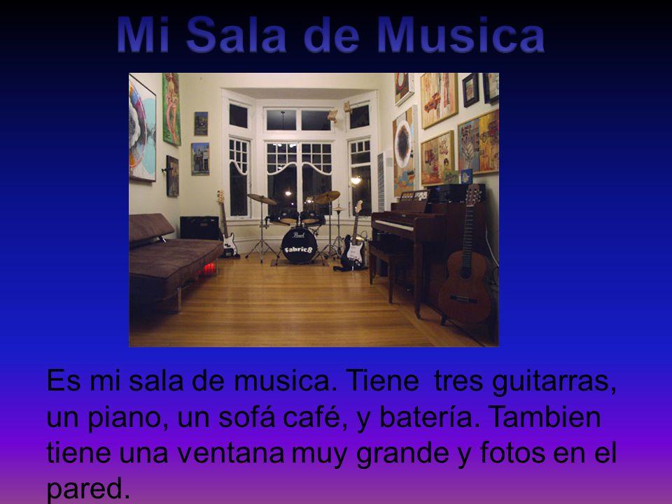 Es mi sala de musica. Tiene tres guitarras, un piano, un sofá café, y batería. Tambien tiene una ventana muy grande y fotos en el pared.