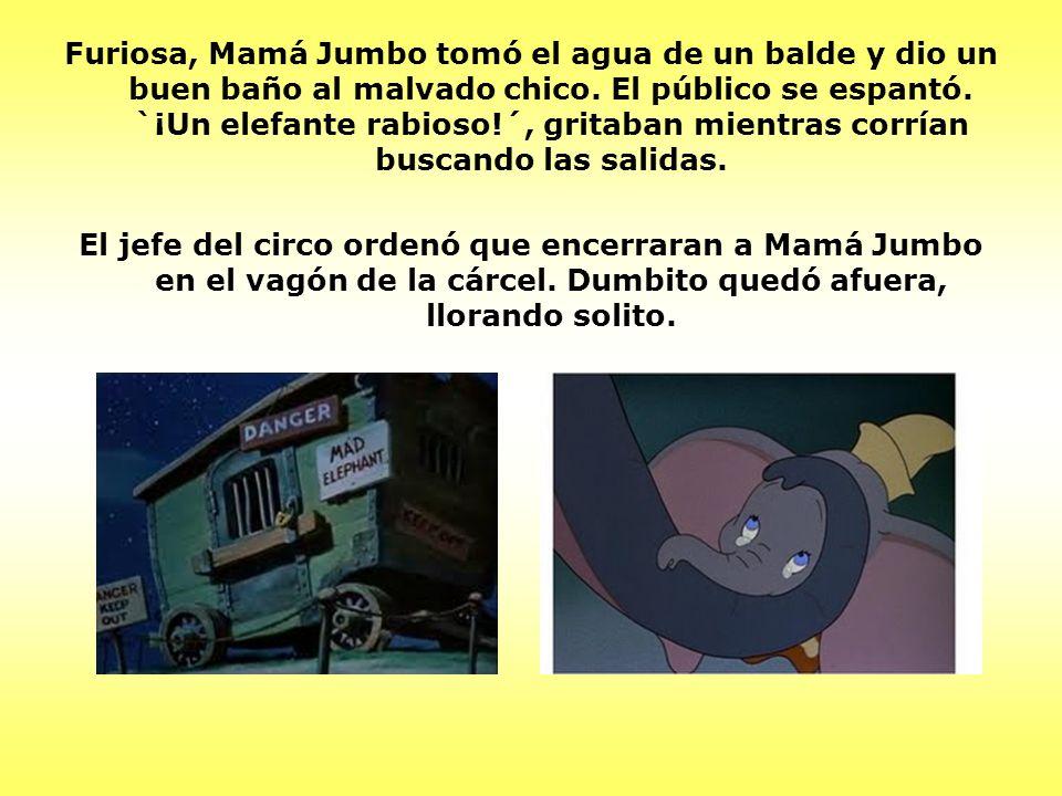 Al día siguiente, el jefe hizo que vistieran a Dumbo de payaso, para que tomara parte en un número de payasadas.