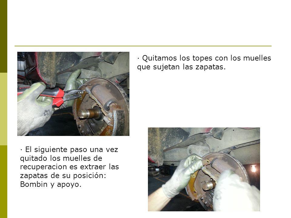· Quitamos los topes con los muelles que sujetan las zapatas. · El siguiente paso una vez quitado los muelles de recuperacion es extraer las zapatas d