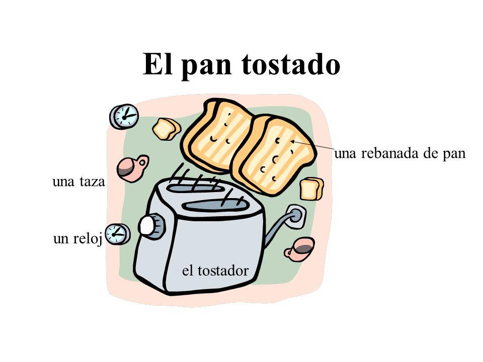 El pan tostado una rebanada de pan el tostador una taza un reloj