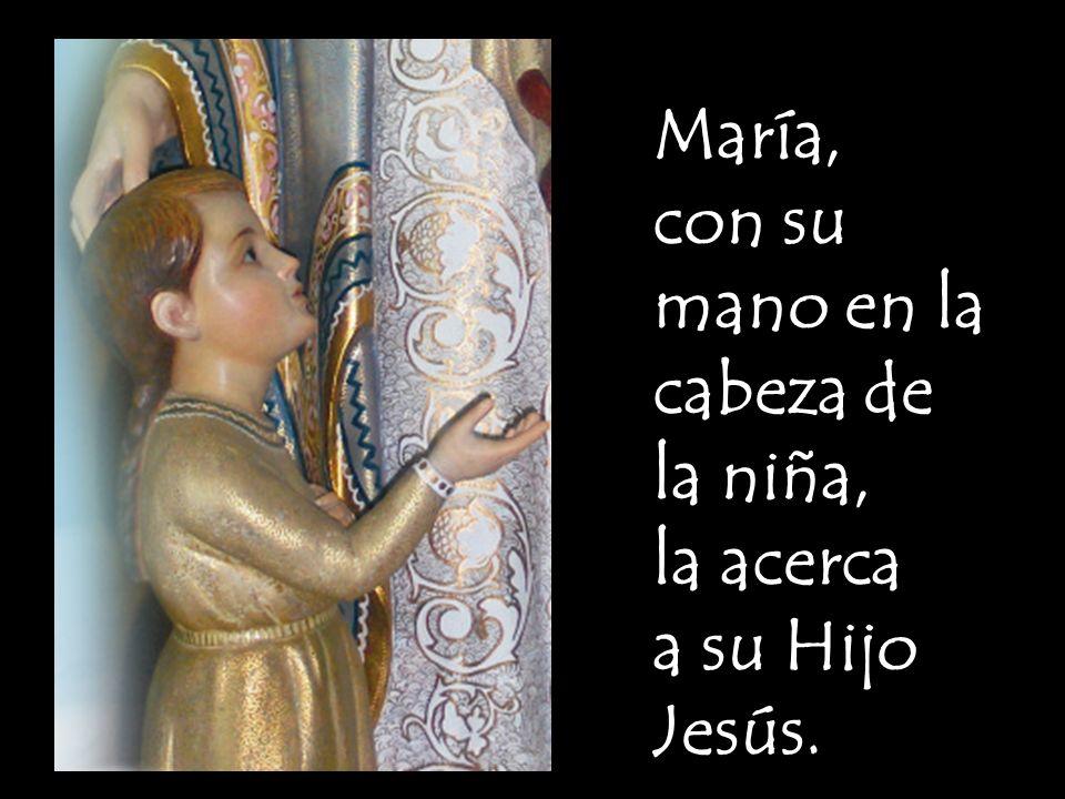 Jesús le da su bendición y le ofrece un pequeño obsequio, un ramito de flores.
