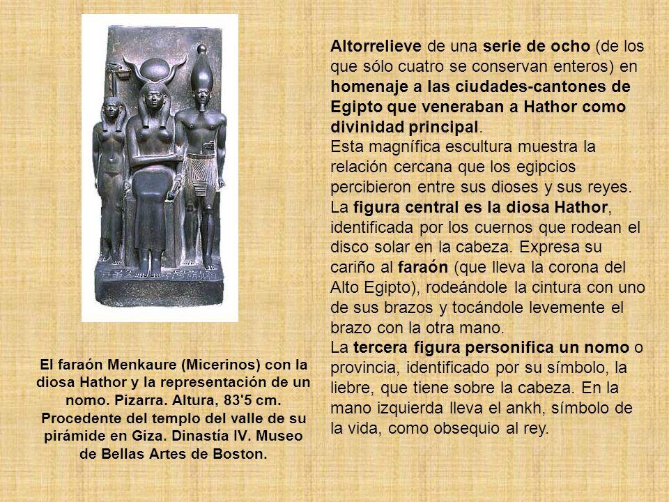 El faraón Menkaure (Micerinos) con la diosa Hathor y la representación de un nomo. Pizarra. Altura, 83'5 cm. Procedente del templo del valle de su pir