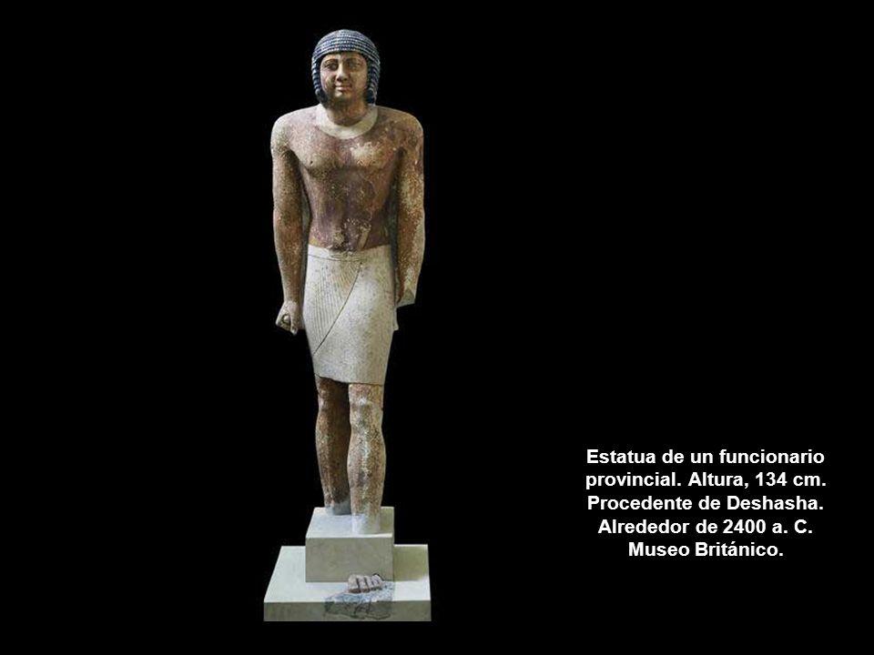 Estatua de un funcionario provincial. Altura, 134 cm. Procedente de Deshasha. Alrededor de 2400 a. C. Museo Británico.