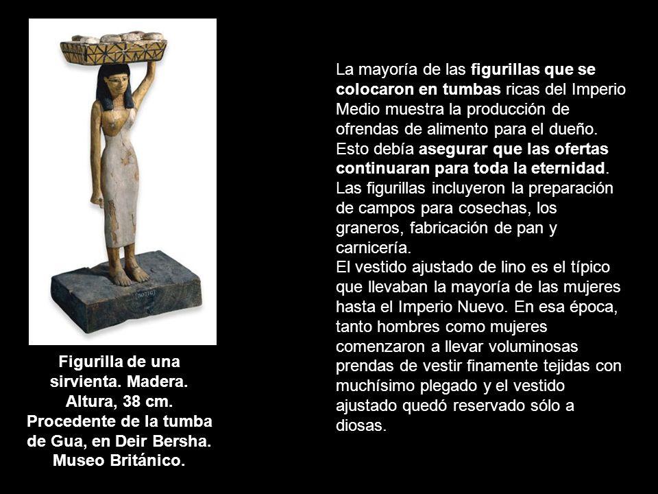 Figurilla de una sirvienta. Madera. Altura, 38 cm. Procedente de la tumba de Gua, en Deir Bersha. Museo Británico. La mayoría de las figurillas que se