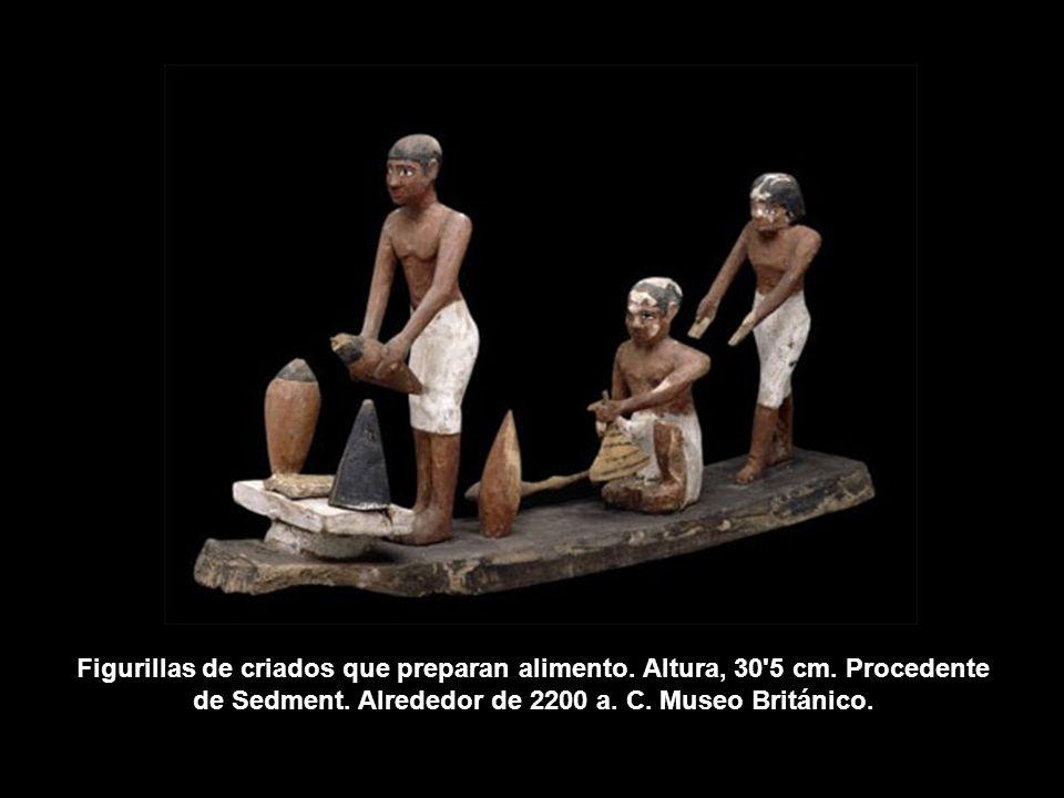Figurillas de criados que preparan alimento. Altura, 30'5 cm. Procedente de Sedment. Alrededor de 2200 a. C. Museo Británico.
