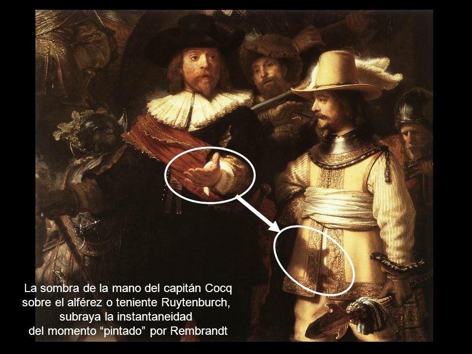 La sombra de la mano del capitán Cocq sobre el alférez o teniente Ruytenburch, subraya la instantaneidad del momento pintado por Rembrandt
