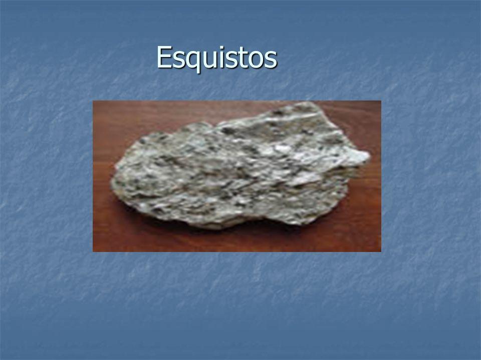 Esquistos Existen varios tipos esquistos tales, granate y cloritos.Su metamorfismo es de grado bajo y se usaban para hacer amuletos y para hacer baldosas y tejas.Su estructura tiene foliación.