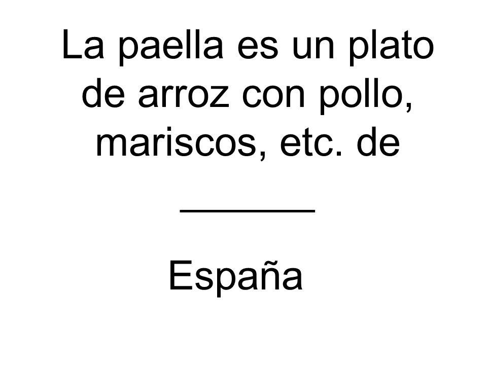 La paella es un plato de arroz con pollo, mariscos, etc. de ______ España