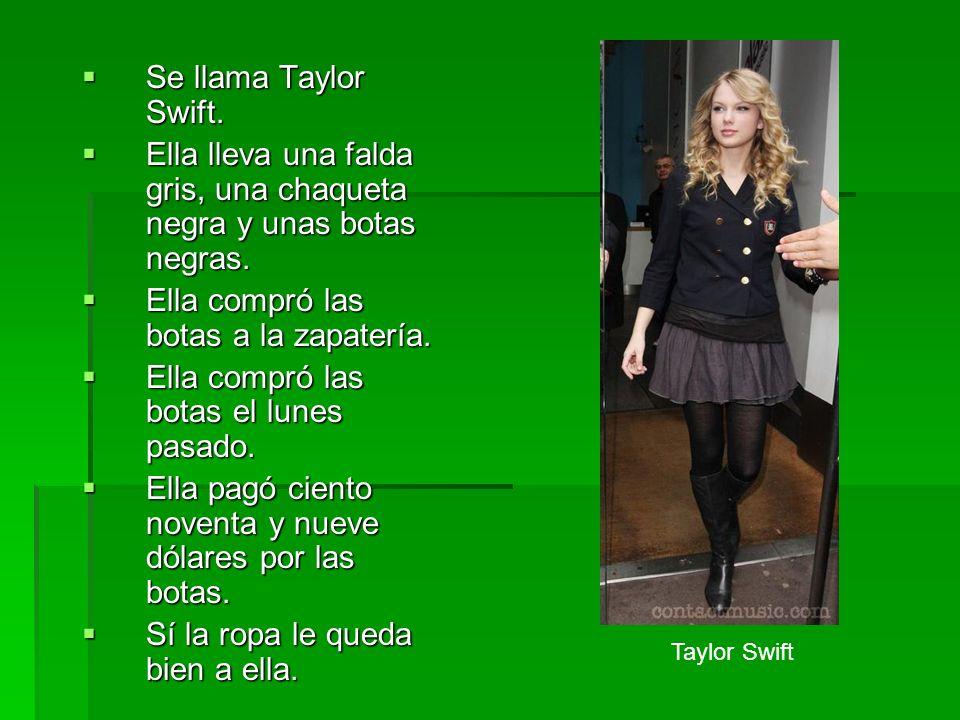 Se llama Taylor Swift. Se llama Taylor Swift. Ella lleva una falda gris, una chaqueta negra y unas botas negras. Ella lleva una falda gris, una chaque