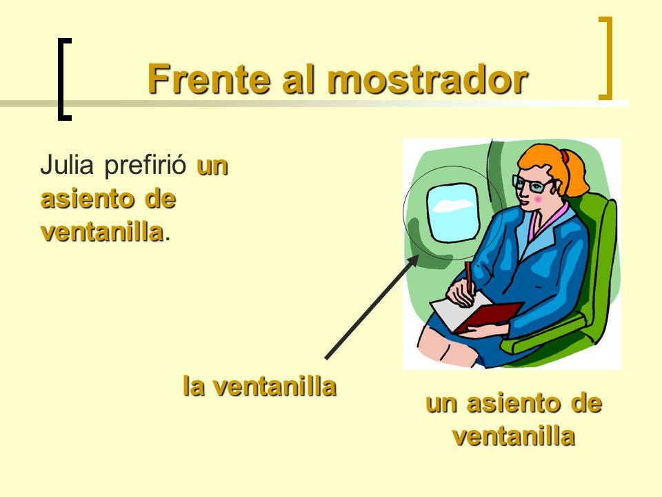 En el avión las salidas de emergencia La auxiliar de vuelo les enseñó las salidas de emergencia a los pasajeros.