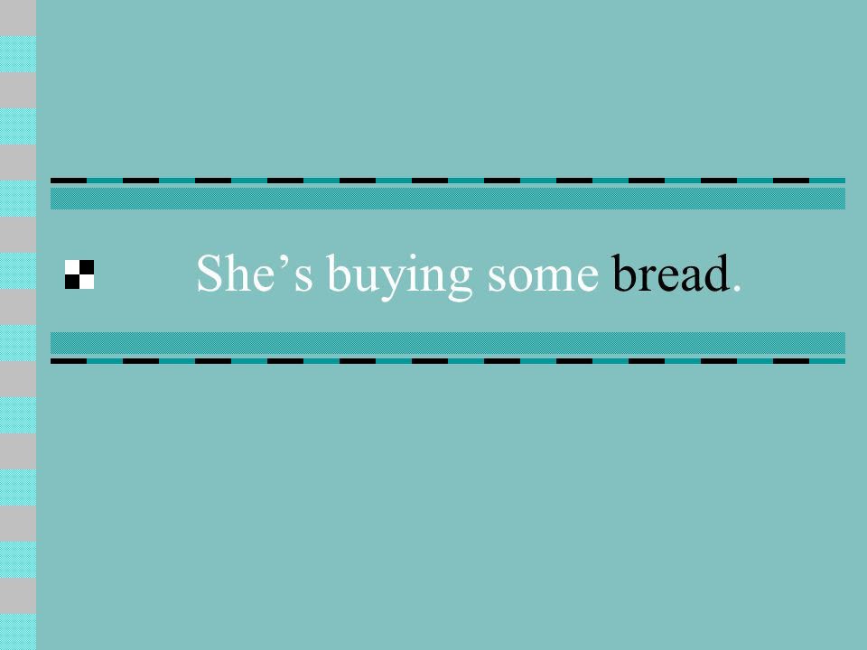 Shes buying some bread.