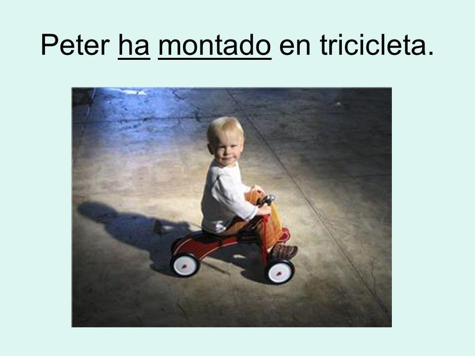 Peter ha montado en tricicleta.