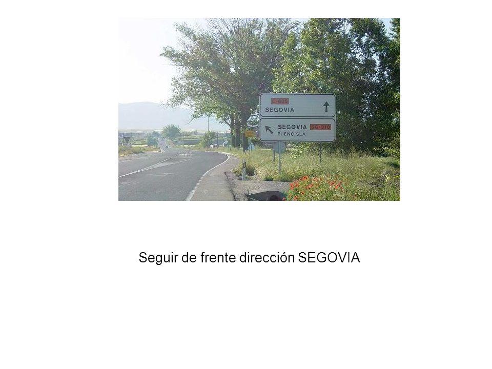Seguir de frente dirección SEGOVIA