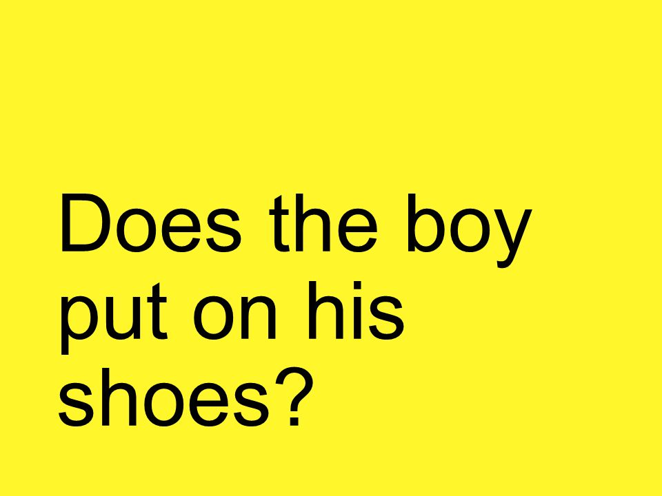 Does the boy put on his shoes